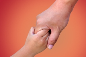 child adult holding hands